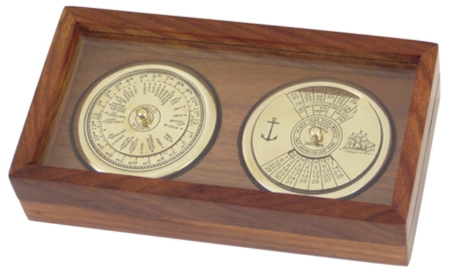 100 year calendar and perpetual world timer in brass finish inside a wooden box with a transparent l