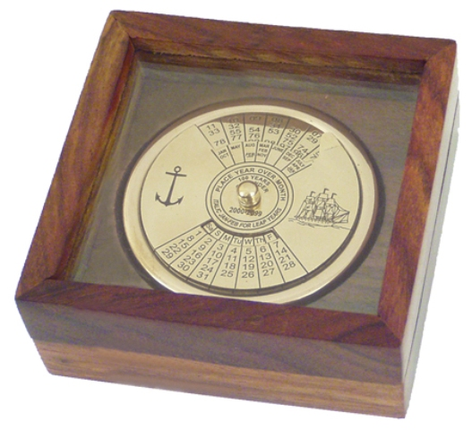 100 year calendar in brass finish inside a wooden box with a transparent lid -  diam : 2''-3''*3''*1